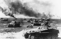 An Sd.Kfz-250 half-track in front of panzer units, as they prepare for an attack, on July 21, 1941, somewhere along the Russian warfront.