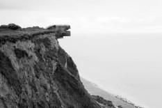 A concrete bunker used by the German Army in World War II sits atop a hill along the route of the Atlantic Wall.