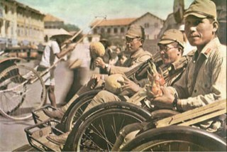 Japanese soldiers of the 5th Infantry Division in the occupied city of Saigon, Indochina, just before being departed to Malaya in December 1941.