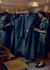 """Wehrmacht uniform factory - Women applying finishing touches to greatcoats. photographs by Dr. Paul Wolff, used in the book """"Uniformen und Soldaten"""" by Curt Ehrlich - published in 1942. Featured is the uniform factory of Peek & Cloppenburg."""