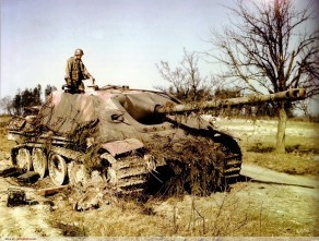 A knocked-out Panzerjäger (tank destroyer) V Jagdpanther Sd.Kfz.173 is examined by an American soldier, probably of the 9th Army. While the date and place of this photo is disputed, the red primer on the vehicle, the soldier's uniform, and the absence of leaves on the trees probably indicate that it was taken during the Americans' advance into Germany in March-April 1945.
