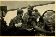 Germany Awakes. Group #32. Picture #91: In the middle of the election campaign, the Führer discusses the travel route with his airplane captain, Baur.