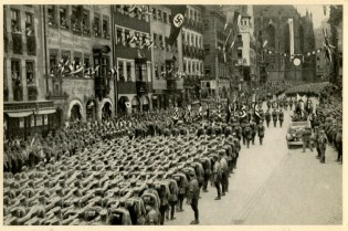Germany Awakes. Group #32. Picture #223: Muster of 100,000 SA men at the party convention in Nuremburg. Marching past the Führer. (Front)