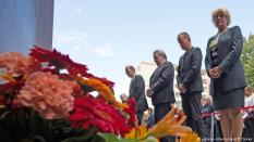 Politicians for the state government of Berlin lay flowers along the site of the Berlin Wall on Bernauer Strasse, 56 years to the day after it was constructed. At least 140 people were shot dead by East German border guards at the wall from 1961 to 1989.