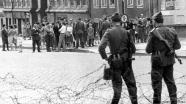 East German authorities began patrolling the inner-German border in 1952. Until then it had been relatively easy to pass between the two. They sealed off West Berlin in 1961. Here, soldiers keep people from crossing as the Berlin Wall is built.