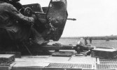 Sdkfz 10 with Flak and Russian POWs.