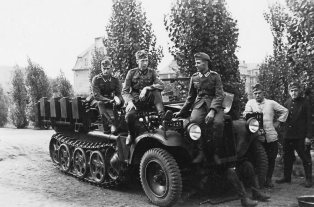 Soldiers next to a SdKfz 10 halftrack.