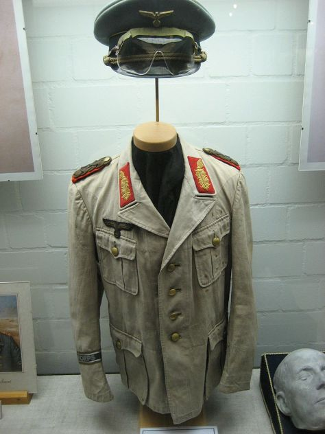 Rommel's Afrika Korps uniform. Note that the color, originally olive, is faded to greenish khaki.