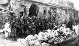 US Army 2nd Infantry Division guard with German prisoners near Schoneseiffen, Germany 1945.
