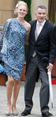 Duchess Elisabeth in Bayern and her husband Daniel Terberger (R) arrive at the Church of Peace in the grounds of Sanssouci Palace, to attend the religious wedding ceremony of Prince Georg Frederich of Prussia and Princess Sophie von Isenburg in Potsdam August 27, 2011. REUTERS/Tobias Schwarz (GERMANY - Tags: ROYALS)