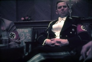 "SS-Gruppenführer Julius Schaub, Hitler's personal aide with the formal title of ""Persönlicher Adjutant des Führers"", wearing an 'SS Grosser Gesellschaftanzug' in a Nazi Party reception held at the Führerbau, 25 February 1939."