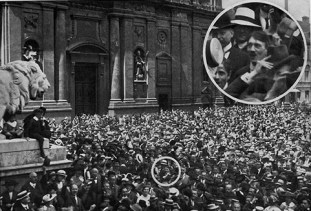 Hoffmann photograph supposedly showing Hitler celebrating the outbreak of World War I in the Odeonsplatz in Munich. The authenticity of the photograph is disputed.