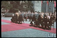 "The state funeral of Hugo Bruckmann (13 October 1863 - 3 September 1941) which was held in Münich, 6 September 1941. Bruckmann and his wife Elsa Bruckmann were among the early and highly influential promoters of Adolf Hitler, and they helped him with gaining access to, and acceptance within, upper-class circles in Münich. Just behind the woman in black veil (sitting third from right) is SS-Brigadeführer Leopold Gutterer (Staatssekretär im Reichsministerium für Volksaufklärung und Propaganda), while the back row behind Gutterer were, from left to right: SS-Brigadeführer Anton Vogler, SS-Obergruppenführer Friedrich ""Karl"" Freiherr von Eberstein, two unknown Heer generals, SS-Brigadeführer Hans Dauser, SA-Obergruppenführer Ludwig Siebert, SS-Obergruppenführer Karl Fiehler (his head is shown under an outstreched hand behind Gutterer), Reichsstatthalter Franz Xaver Ritter von Epp (wearing brown party uniform), and SA-Obergruppenführer Hans-Georg Hofmann."