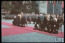 "The state funeral of Hugo Bruckmann (13 October 1863 - 3 September 1941) which was held in Münich, 6 September 1941. Bruckmann and his wife Elsa Bruckmann were among the early and highly influential promoters of Adolf Hitler, and they helped him with gaining access to, and acceptance within, upper-class circles in Münich. Just behind the woman in black veil (sitting third from right) is SS-Brigadeführer Leopold Gutterer (Staatssekretär im Reichsministerium für Volksaufklärung und Propaganda), while the back row behind Gutterer were, from left to right: SS-Brigadeführer Anton Vogler, SS-Obergruppenführer Friedrich ""Karl"" Freiherr von Eberstein, two unknown Heer generals, SS-Brigadeführer Hans Dauser, SA-Obergruppenführer Ludwig Siebert, SS-Obergruppenführer Karl Fiehler (his head is shown under an outstreched hand behind Gutterer), Reichsstatthalter Franz Xaver Ritter von Epp (wearing brown party uniform), and SA-Obergruppenführer Hans-Georg Hofmann."