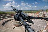 A captured Belgian Army 120 mm gun used as a battery gun in a dedicated circular parapet.