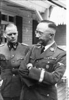 Werner Grothmann (left) next to Heinrich Himmler in 1943.