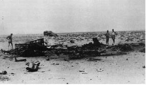 The wreckage of Werknummer 14 256, 30 September 1942; the vehicle in the background marks the spot where Marseille's body landed.