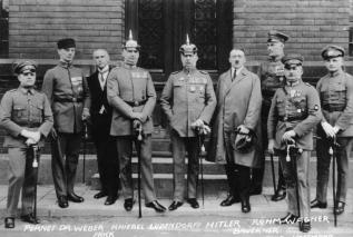 Defendants in the Beer Hall Putsch trial. From left to right: Pernet, Weber, Frick, Kiebel, Ludendorff, Hitler, Bruckner, Röhm, and Wagner. Note that only two of the defendants (Hitler and Frick) were wearing civilian clothes.