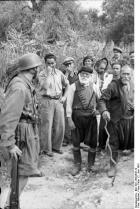 Fallschirmjäger paratroopers at Kondomari, Crete confronting Cretan Greek villagers.