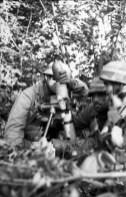 """A Fallschirmjäger mortar crew firing the 8 cm Granatwerfer 42 """"Stummelwerfer""""."""