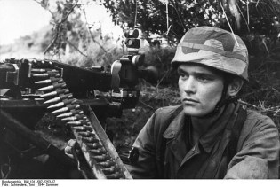 A German paratrooper MG 42 mounted on a Lafette 42 tripod with MG Z 40 telescopic sight attached.