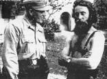 Commander of the 13th SS Division, SS-Standartenführer Desiderius Hampel confers with a Chetnik commander in the summer of 1944.