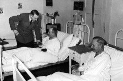 Adolf Hitler second visit to the victims of the 20 July 1944 assassination attempt at the Karlshof Hospital near Rastenburg (which was located some 7 kilometers away from Führerhauptquartier Wolfsschanze) on 1 August 1944. Hitler next to the sick-bed of Kapitän zur See Heinz Assmann, Admiral's Staff Officer in the Wehrmacht High Command, and Konteradmiral Karl-Jesko von Puttkamer, Hitler's Naval Adjutant.