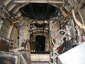 Inside Wk Nr 701152 He 111 H-20. Looking forward to the first bulkhead from the ventral gunner's position. The control column and cockpit glazing is visible in the central background.