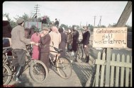 Refugees clogging road near Warsaw during German invasion of Poland (sign [in German] warns: DANGER ZONE -- DO NOT PROCEED)
