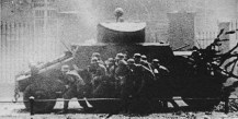 SS men attacking under cover of ADGZ vehicle.