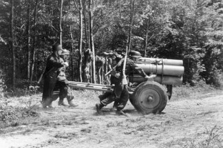 A 21 cm Nebelwerfer 42 being manoeuvred into position in France, 1944.