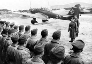 Erhard Milch addressing a Ju 87 staffel on a Norwegian airfield.