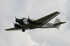 """Lufthansa's 21st-century airworthy heritage Ju 52/3mg2e (Wk-Nr 5489) in flight, showing the Doppelflügel, """"double wing"""" trailing edge control surfaces."""