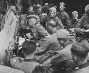 Lieutenant Colonel Hans Traut (smoking) with his men of the Infantry Regiment 90 during the France campaign.