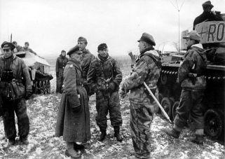 Major General Hasso von Manteuffel (left), Colonel Adelbert Schulz (center) and right Colonel Friedrich-Carl von Steinkeller in discussion.