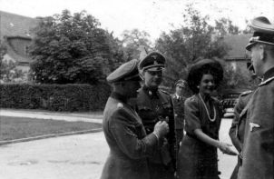 SS Obergruppenfuhrer and General of Waffen-SS Dietrich with his young wife Ursula, divorced Brenner, and SS war correspondent Gunter d'Alquen.