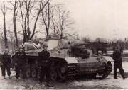 The coffin of Major General Schulz rests on the old command tank of the tank commander, in which he had driven many victorious attacks.