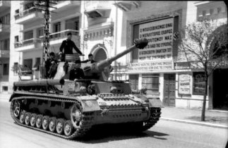 """German Panzer IV in Thessaloniki. The banner on the building in the background reads """"Bolshevism is the greatest enemy of our civilization""""."""