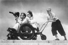 Leni Riefenstahl behind cameraman at the 1936 Summer Olympics.