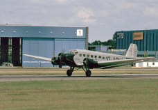 """A Lufthansa Junkers Ju 52/3m (registered D-CDLH), until 1984, known as """"Iron Annie N52JU"""", painted as D-AQUI in historic 1936 Deutsche Luft Hansa colors. D-CDLH has P&W engines, now with three-bladed propellers (ex Caiden)."""