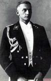 SS Untersturmfuhrer Hugo Gottfried Kraas wearing a SS suit with shoulder straps.
