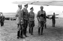 From left: Italian General Ercole Roncaglia, Kurt Waldheim, Oberst (Colonel) Macholz and Phleps (with briefcase) at Podgorica airfield in Montenegro during Case Black, 22 May 1943. This photograph caused much controversy when it was published while Waldheim was running for the Austrian presidency in 1985–1986.