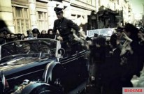People enthusiastically greet Hitler on a ride through Münich in a Mercedes-Benz 770 open car, 1942. Standing in the back seat is his personal Adjutant, SS-Untersturmführer Otto Günsche. The picture was taken by Walter Frentz, one of Hitler's personal photographer