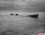 A Coast Guard row boat picking survivors up from U-175.