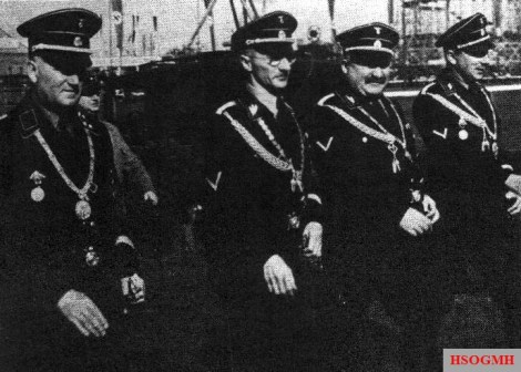 City councilors of Munich Ulrich Graf , Karl Fiehler (Lord Mayor), Christian Weber and Emil Maurice , Oktoberfest 1938.