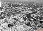 Berlin, like most cities in Germany, lay in ruins when World War II came to an end. Reichstag in the middle on the left.