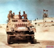 German Afrikakorps soldiers in an armored personnel carrier Sd.Kfz.251/1 (Sonderkraftfahrzeug 251) Ausf.B advances past the fortified Fort Mechili in Cyrenaica/Libya, Western Desert, North Africa, 8 April 1941.