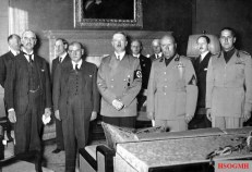 From left to right, Neville Chamberlain, Édouard Daladier, Adolf Hitler, Benito Mussolini and Italian Foreign Minister Count Ciano as they prepare to sign the Munich Agreement.