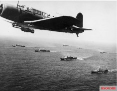 "A SB2U Vindicator scout bomber from USS Ranger flies anti-submarine patrol over Convoy WS-12, en route to Cape Town, November 27, 1941. The convoy was one of many escorted by the US Navy on ""Neutrality Patrol"", before the US officially entered the war."