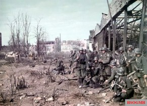 A German assault team from 113. Infanterie-Division, supported by StuG III Ausf.F from Sturmgeschütz-Abteilung 244, pause before another attack close to the remains of the Dzershinzky Tractor Factory in Stalingrad, 15 October 1942.
